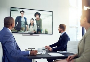 Shot of a diverse team of colleagues having a video conference in a modern office